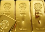 Gold bounces off 6-week low with U.S. dollar, data in focus