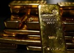 PRECIOUS-Gold recovers from 10-mth lows as investors look for bargains