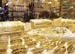 Gold prices down slightly in early Asia in thin trade