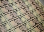 Dollar slides broadly lower ahead of U.S. data, Fed