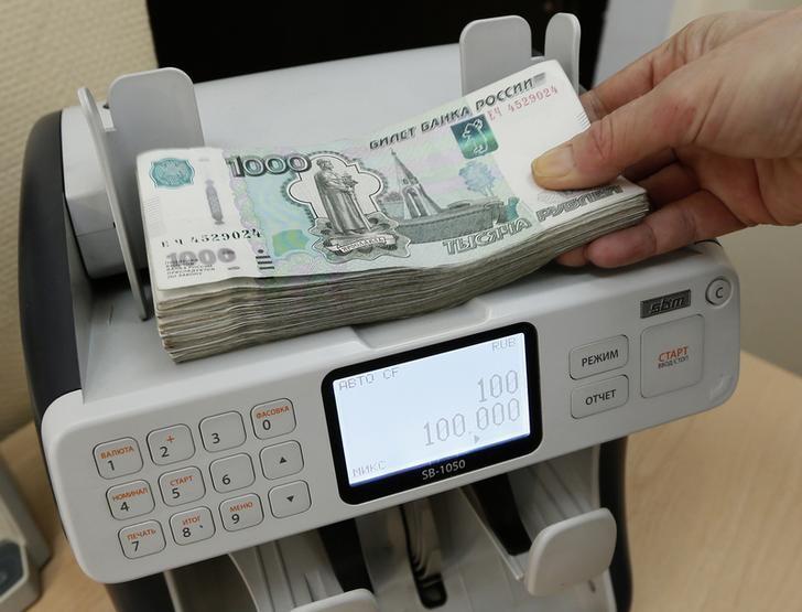 © Reuters.  Рубль продемонстрировал почти рекордную зависимость от нефти