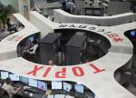 Shares in Tokyo gain after retail sales data, investors eye Greece