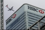Britain's bank tax jump threatens to push HSBC, StanChart to new home