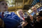 Shares gain on China stimulus; Greece worries weigh on euro