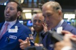 Wall St. edges up as results ease anxiety over earnings