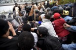 Thousands march in Baltimore to protest black man's death, some damage