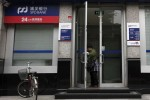 Cuts to pay and perks trigger flight from China's state banks