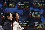 Asian shares inch up; focus on central banks, Greece