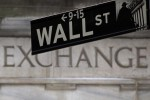 Wall St. declines, weighed down by healthcare