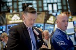 Wall St. ends lower on weak trade data; investors eye Fed