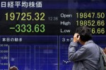 Asian stocks at two-week lows, bond woes spread, dollar slips