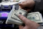 Dollar, Chinese shares steady as Europe wobbles