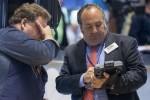 Wall Street opens lower on Greece worries