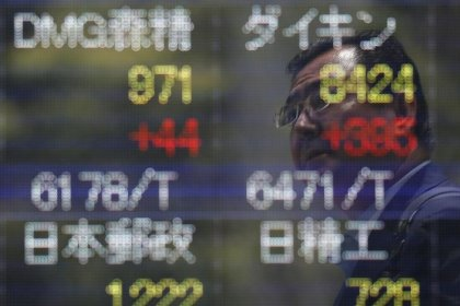 Asia slips on weaker Wall Street, dollar marks time before Yellen