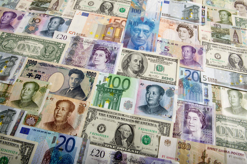 Dollar slides against firmer yen, euro steady