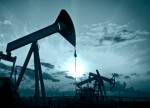 Crude falls to monthly-low, as investors await weekly supply reports