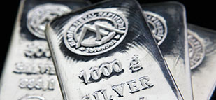 Silver rallies to 5-week high as dollar drops on Fed outlook