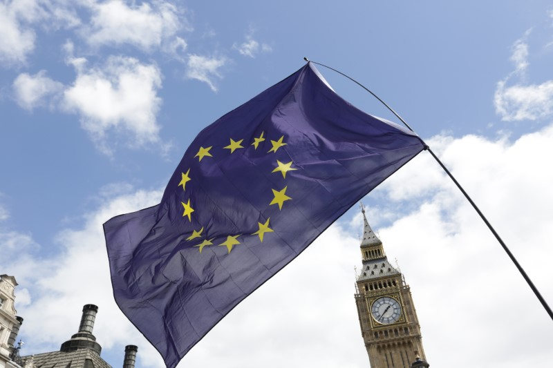 © Reuters. File photo of a European Union flag held in front of the Big Ben clock tower in Parliament Square during a 'March for Europe' demonstration
