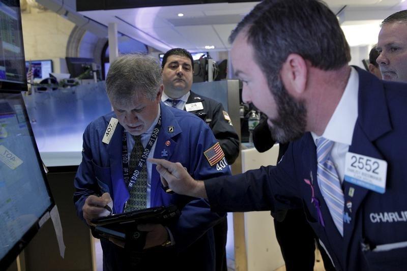 Wall Street rallies late; biotechs, materials boost