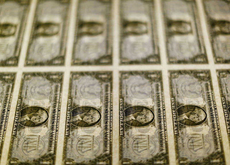 © Reuters. File photo of United States one dollar bills seen on a light table at the Bureau of Engraving and Printing in Washington